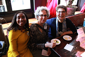 Lilly Marcelin of Resilient Sisterhood Project, Marla Cummins, and Clean Water Action Advisory Board Member Ellie Goldberg enjoy some delicious hors d'ouevres.