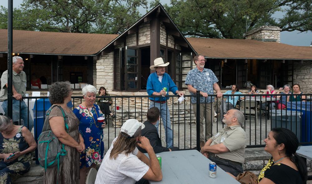 Jim Hightower and Texas Director David Foster address attendees.