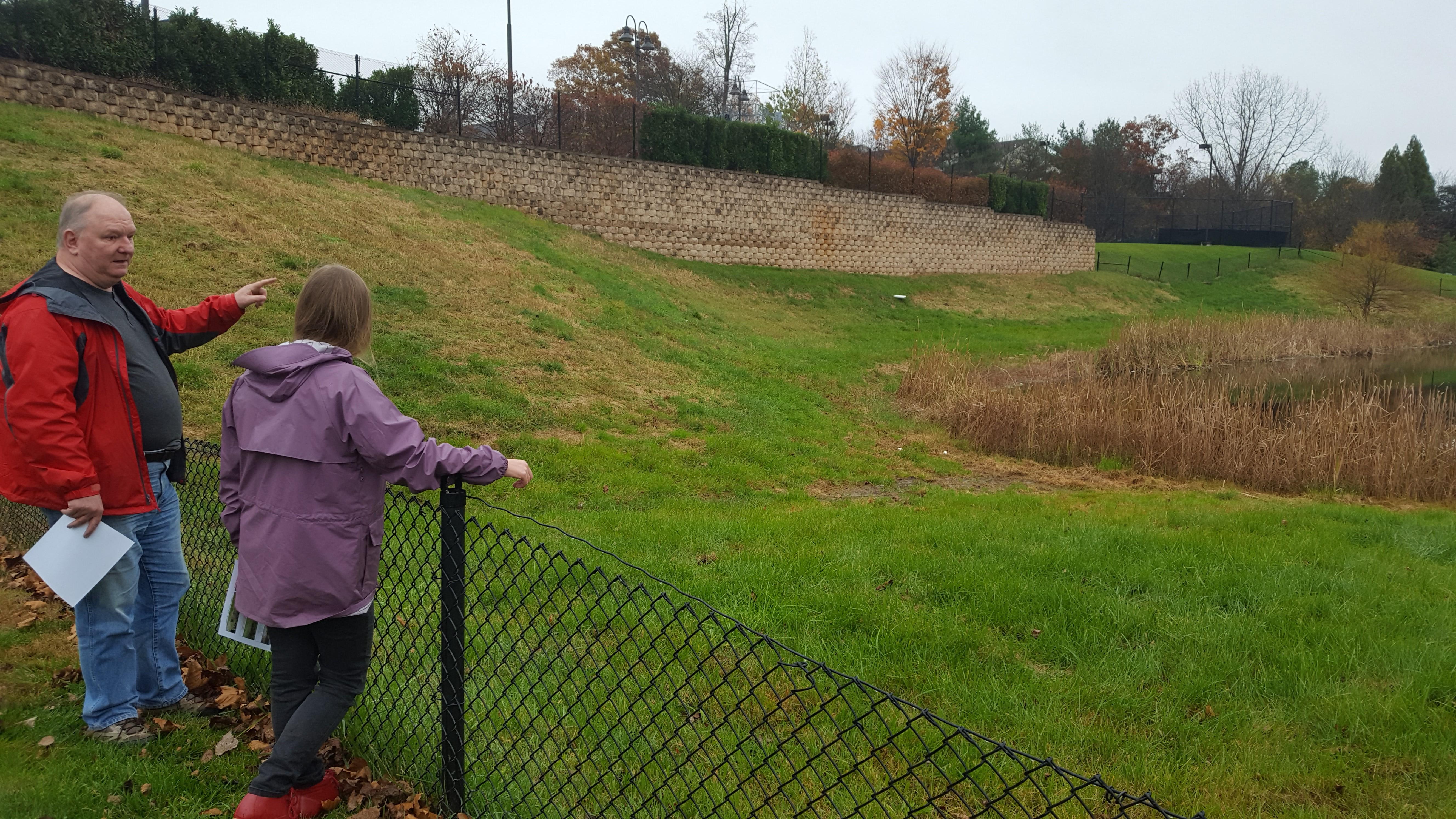 Richard and Jennifer look at a failing infiltration basin