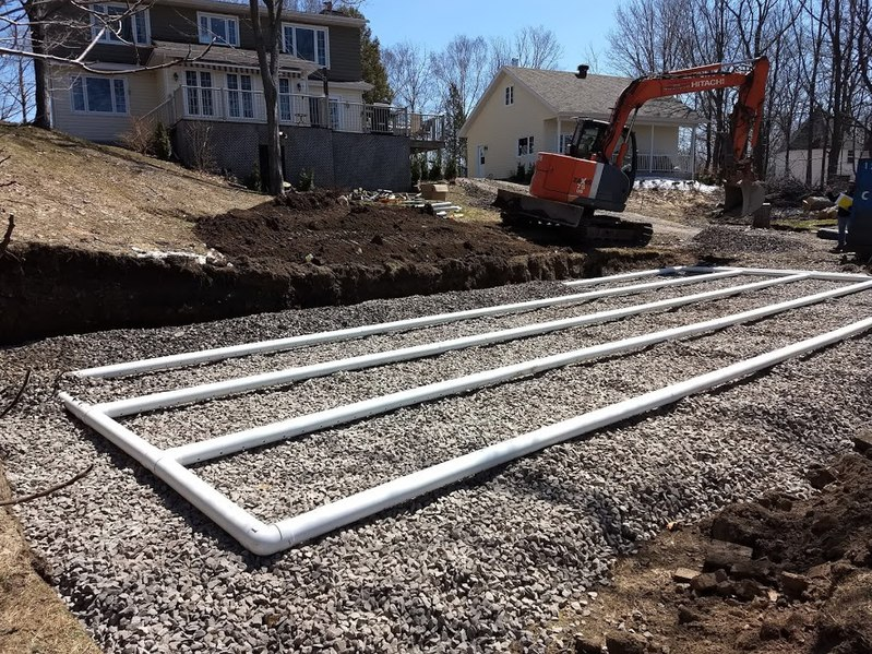 The drain field component of a residential septic system is being put in place. Creative Commons license.