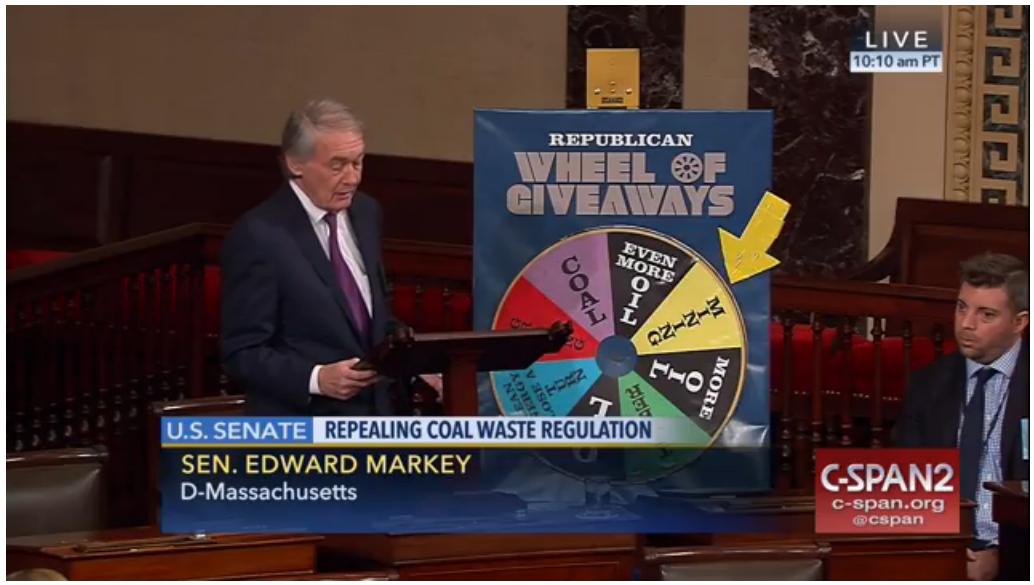 Senator Markey (D-MA) and the Wheel of Giveaways. Screenshot from CSPAN