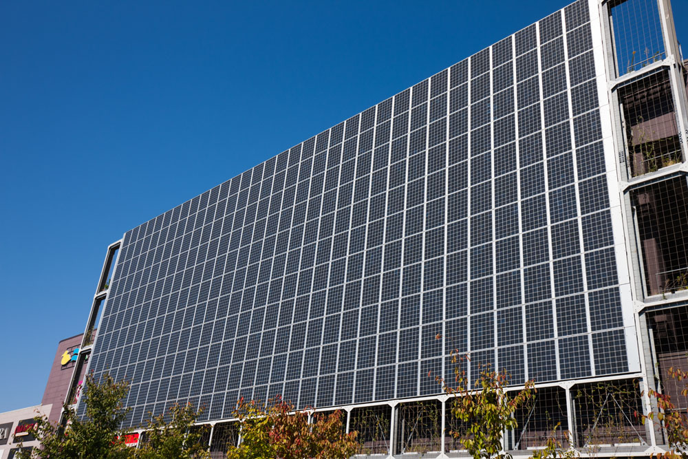 Solar panels on the side of a building. Credit: yoshi0511 / Shutterstock