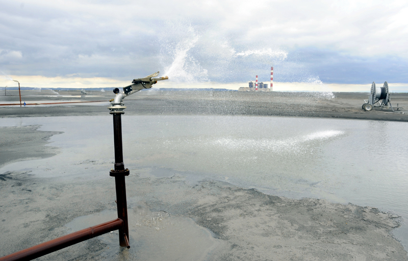 Sprinkler at a coal ash disposal site. Photo credit: bibiphoto / Shutterstock