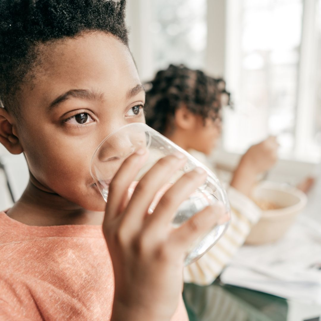 Kid drinking water from a glass