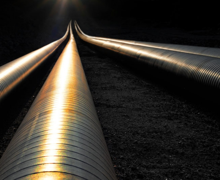 Pipelines reflecting sunset. Photo credit Amy Johansson / Shutterstock