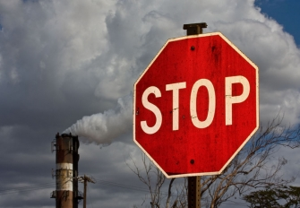 Smokestack and stop sign