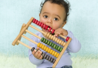 Child playing with toy. Photo credit: Studio-Annika / Shutterstock