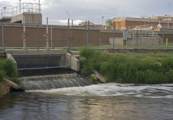 Water treatment plant discharging to a river. Photo credit: marekuliasz / Shutterstock